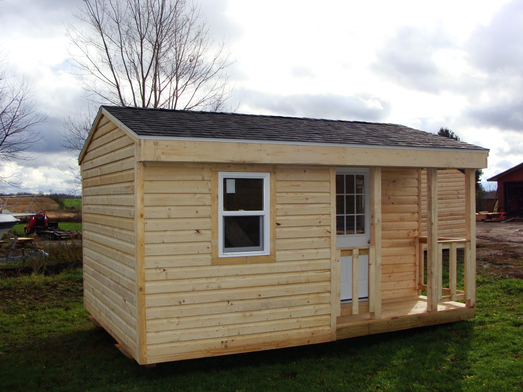 Custom hand built cabins hunting camps and small for Camps and cottages